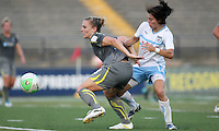 Philadelphia forward, Amy Rodriguez (8), shields the ball from Chicago midfielder, Karen Carney (14).  The Philadelphia Independence shut out the Chicago Red Stars, 3-0 on two goals from Amy Rodriguez and one from Caroline Seger at John A Farrell Stadium in West Chester, Pennsylvania.