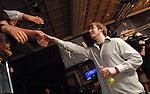 Daniel Schreiber gets a handshake from friends after winning the event.