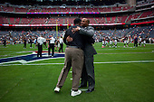 Houston, Texas<br /> October 2, 2011<br /> <br /> Greeting a friend in the center of the stadium's field, general manager and first as executive vice president, Rick Smith oversees all aspects of football operations. Smith has strengthened Houston's roster through the draft, free agency and several trades at key positions.<br /> <br /> The Houston Texans defeated the Pittsburgh Steelers at the Reliant Stadium 17 to 10.