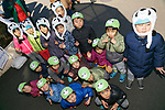 Children pose for a photograph after meet new giant panda cub Xiang Xiang at Tokyo's Ueno Zoo on December 19, 2017, Tokyo, Japan. The new female panda cub Xiang Xiang, born June 12, 2017, is being shown to the public for the first time. More than one thousand visitors are expected to come to see the panda on the day of her public debut. (Photo by Rodrigo Reyes Marin/AFLO)