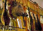Italy, Tuscany, San Gimignano: decoration in a ham selling shop