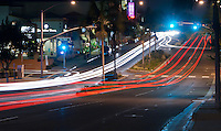 The intersection of Pacific Coast Highway and Iris Avenue in downtown Corona Del Mar (Newport Beach), CA taken shortly after dusk on a Monday night.