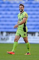 Ben Foden of Northampton Saints enjoys a lighter moment during the Premiership Rugby match between London Irish and Northampton Saints at the Madejski Stadium on Saturday 4th October 2014 (Photo by Rob Munro)