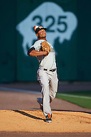 Norfolk Tides starting pitcher Ariel Miranda (35) warms up in the bullpen before a game against the Buffalo Bisons on July 18, 2016 at Coca-Cola Field in Buffalo, New York.  Norfolk defeated Buffalo 11-8.  (Mike Janes/Four Seam Images)