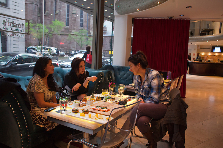 Izzy Katz (right), Laura Trevino (center), and Shana Pederson (left), enjoy food and music at Toshi's Living Room, located on the bottom floor of the Flatiron Hotel, located at 1141 Broadwaty, New York, NY...There is a restaurant/bar boom happening on 26th Street between Broadway and 7th Avenue in Manhattan. About six new places have opened up in the last 8 months. This area of development is called NoMad (north of Madison Sq. Park)...Photographed on 4/23/13 by Mark Abramson for The Wall Street Journal.