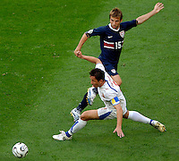 U.S. midfielder Bobby Convey (15) plays the ball around Czech Republic captain Tomas Galasek (4). The Czech Republic defeated the USA 3-0 in their FIFA World Cup Group E opening match at FIFA World Cup Stadium, Gelsenkirchen, Germany, on Monday, June 12, 2006.