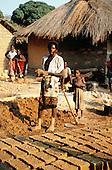 Kalepo, Tanzania. Making adobe bricks for building houses.