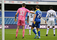 Dejan Iliev of Shrewsbury Town pushes Ryan Longman of AFC Wimbledon back during AFC Wimbledon vs Shrewsbury Town, Sky Bet EFL League 1 Football at The Kiyan Prince Foundation Stadium on 17th October 2020