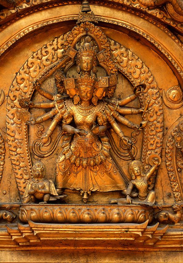 Gold Repousse of the Buddhist deity Avalokiteshwara graces the Sun Dokha or golden gate, created by Jaya Ranjit Malla in 1753 - Bhaktapur, Nepal