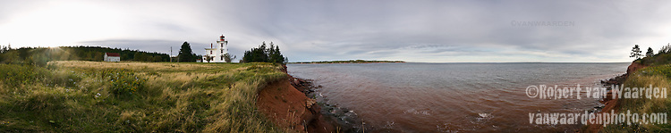 Panorama of lighthouse and coast, Prince Edward Island, Canada.
