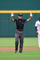 Umpire Trey Ward calls for time during a game between the FCL Orioles Orange and FCL Braves on July 22, 2021 at the CoolToday Park in North Port, Florida.  (Mike Janes/Four Seam Images)