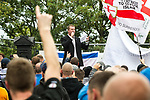© Joel Goodman - 07973 332324 . 13/08/2011 . Shropshire , UK . EDL leader KEVIN CARROLL delivers a speech . Approximately 300 EDL supporters demonstrate against a paedophile ring in the small Telford town of Wellington . The group had planned to march, however the Home Secretary has imposed a ban on all marches in the area just days after riots have swept across England. A counter-demonstration has attracted about 300 people . Photo credit : Joel Goodman
