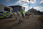 Oldham Athletic 0 Hartlepool United 0, 18/09/2021. Boundary Park, League 2. Police horses move off on patrol before Oldham Athletic play Hartlepool United in a League 2 fixture at Boundary Park. Before the game, more than home 500 fans protested against owner Abdallah Lemsagam's running of the club, including some who carried a mock coffin outside the ground. The match ended 0-0, watched by 3934 spectators. Photo by Colin McPherson.
