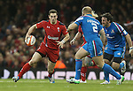 Wales wing George North takes on Italian pair Leonardo Ghiraldini and Mauro Bergamasco.<br /> RBS 6 Nations 2014<br /> Wales v Italy<br /> Millennium Stadium<br /> 01.02.14<br /> <br /> ©Steve Pope-SPORTINGWALES