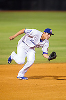 Chattanooga Lookouts shortstop Corey Seager (12) charges a ground ball during the game against the Montgomery Biscuits at AT&T Field on July 24, 2014 in Chattanooga, Tennessee.  The Biscuits defeated the Lookouts 6-4. (Brian Westerholt/Four Seam Images)