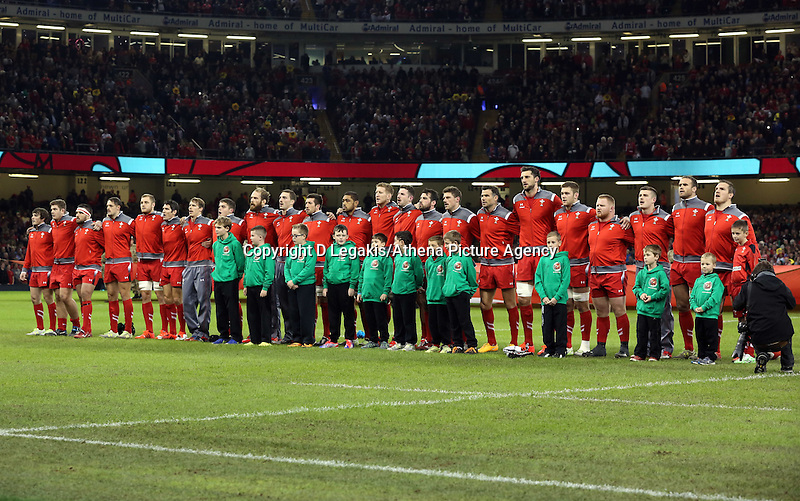 Pictured: The Wales team singing their national anthem. Saturday 15 November 2014<br /> Re: Dove Men Series rugby, Wales v Fiji at the Millennium Stadium, Cardiff, south Wales, UK.