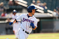 Tennessee Smokies right fielder Darius Hill (1) hustles to first base against the Rocket City Trash Pandas at Smokies Stadium on July 2, 2021, in Kodak, Tennessee. (Danny Parker/Four Seam Images)
