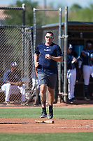 San Diego Padres pitcher Adrian Morejon retrieves a bat during an Instructional League game against the Milwaukee Brewers at Peoria Sports Complex on September 21, 2018 in Peoria, Arizona. (Zachary Lucy/Four Seam Images)