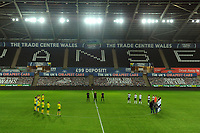 Players from both teams take part during the minutes applause during the Sky Bet Championship match between Swansea City and Norwich City at the Liberty Stadium in Swansea, Wales, UK. Friday 05 February 2021