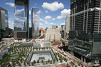 Tenth anniversary of 9/11.  Rebuilding at the World Trade Center site.  The view from south side of site shows L to R: Goldman Sachs, 1 WTC, 7 WTC, the postal building and the under-construction 4 WTC.   The 9/11 Memorial is situated around the footprints of the original towers.   Photo by Ari Mintz.  8/22/2011.