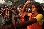 A women is performing black magic while hindu pilgrims pray to Sun god on the bank of river Gandak during Sonepur fair. Bihar, India, Arindam Mukherjee.
