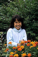 HS18-041z  Child with marigolds - Tagetes spp.