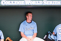 North Carolina third baseman Colin Moran (18) in the dugout before Game 10 of the 2013 Men's College World Series against the North Carolina State Wolfpack on June 20, 2013 at TD Ameritrade Park in Omaha, Nebraska. The Tar Heels defeated the Wolfpack 7-0, eliminating North Carolina State from the tournament. (Andrew Woolley/Four Seam Images)