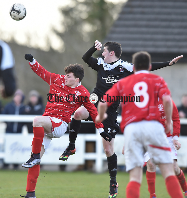 Ian Collins of Newmarket Celtic in action against John Boyle of Janesboro during their Munster League Champions Trophy final at The County Grounds, Doora. Photograph by John Kelly.