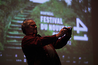 October 10, 2012 - Montreal. Quebec , Canada - Claude Chamberland  take a photo of the crowd at the <br /> Opening of Montreal New Cinema Festival (Festival du Nouveau Cinema de Montreal) at Place des arts  with LA MISE A L'AVEUGLE directed by Simon Galiero