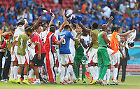 Costa Rica players celebrate on the final whistle after victory over Italy