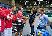 Switserland, Genève, September 16, 2015, Tennis,   Davis Cup, Switserland-Netherlands, The living legend has arrived, Roger Federer makes his apearance in the Plaxepo and is greeted by Dutch team doctor Babette Pluim, right KNLTB director Erik Poel, left Marco Chiudinelli<br /> Photo: Tennisimages/Henk Koster