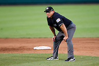 Third Base Umpire Mike Mazzarissi watches for a balk during a game between the Northwest Arkansas Naturals and the Springfield Cardinals at Hammons Field on July 30, 2011 in Springfield, Missouri. Springfield defeated Northwest Arkansas 11-5. (David Welker / Four Seam Images)