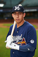 Mississippi Braves shortstop Daniel Castro (20) poses for a photo before a game against the Mobile BayBears on April 28, 2015 at Hank Aaron Stadium in Mobile, Alabama.  The game was suspended after the top of the second inning with Mobile leading 3-0, the BayBears went on to defeat the Braves 6-1 the following day.  (Mike Janes/Four Seam Images)