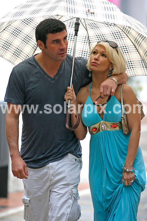 """**ALL-ROUND EXCLUSIVE PICTURES FROM SOLARPIX.COM**.**WORLDWIDE SYNDICATION RIGHTS**.Undefeated World Super Middleweight boxing Champion Joe Calzaghe 38, took his Strictly Come Dancing girlfriend Kristina Rihanoff 32, out for a romantic lunch in Orange Square, in the old town of Marbella this week. The """"Italian Dragon"""" then took the beautiful Siberian dance instructor shopping. They were seen looking at rings in an antique jewellery shop and enjoyed an ice cream which they shared while walking through the back street. The couple have been spending a few days  at a luxury beach & Spa resort together, relaxing after Kristina's latest dance tour. .This pic: Joe Calzaghe & Kristina Rihanoff.JOB REF: 11232        AB/SF       DATE:   22.05.10.**MUST CREDIT SOLARPIX.COM OR DOUBLE FEE WILL BE CHARGED**.**MUST AGREE FEE BEFORE ONLINE USAGE**.**CALL US ON: +34 952 811 768 or LOW RATE FROM UK 0844 617 7637**."""