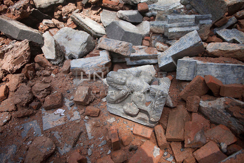 An artefact lays in the ground at Gorok Nath temple in Kathmandu, Nepal