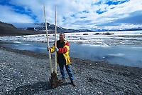 man holding narwhal tusk, Monodon monoceros, Rare Double Tusk, Baffin Island, Nunavut, Canada, Canadian Arctic