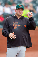 Augusta GreenJackets pitching coach Steve Kline (34) signals to the bullpen to see if the relief pitcher is ready to go during the South Atlantic League game against the Greensboro Grasshoppers at NewBridge Bank Park on August 11, 2013 in Greensboro, North Carolina.  The GreenJackets defeated the Grasshoppers 6-5 in game one of a double-header.  (Brian Westerholt/Four Seam Images)