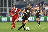 USWNT midfielder Lauren Cheney (12) makes a move on Christina Julien.....USWNT played to a 1-1 tie with Canada at LIVESTRONG Sporting Park, Kansas City, Kansas.