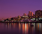 Retro Image of San Francisco downtown Ghiradelli Square at sunset with city lights reflected in bay, San Francisco, California USA