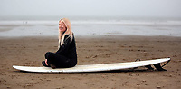 PR PHOTOGRAPHY, A young female surfer in Aberavon Beach, Wales, UK
