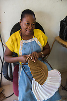 Haiti, Port-au-Prince, Caribbean Craft, artisans factory making products mostly in paper mache and metal work for export. Produce products for outlets such as Toms, and West Elm. Woman making paper mache products. Run by Magalie Noel Dresse