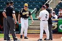 Coach Gene Stephenson (10) of the Wichita State Shockers meets with Umpires and Coach Keith Guttin (2) of the Missouri State Bears prior to a game against the Missouri State Bears on April 9, 2011 at Hammons Field in Springfield, Missouri.  Photo By David Welker/Four Seam Images