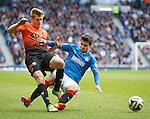 Richard Foster tackles Stuart Armstrong