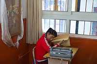A visually impaired Tibetan student reads a braille book during a lesson at the School for the Blind in Tibet, in the capital city of Lhasa, September 2016.