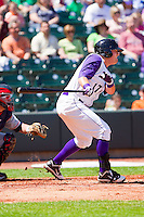 Andy Wilkins #17 of the Winston-Salem Dash follows through on his swing against the Kinston Indians at BB&T Ballpark on April 17, 2011 in Winston-Salem, North Carolina.   Photo by Brian Westerholt / Four Seam Images
