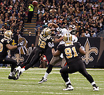 December 2009: New Orleans Saints linebacker Jonathan Casillas (52) pressures Tampa Bay Buccaneers quarterback Josh Freeman (5) during an NFL football game at the Louisiana Superdome in New Orleans.