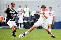 Colin Rolfe (9) of the Louisville Cardinals and Daniel Fabian (19) of the Providence Friars go for the ball. The Louisville Cardinals defeated the Providence Friars 3-2 in penalty kicks after playing to a 1-1 tie during the finals of the Big East Men's Soccer Championship at Red Bull Arena in Harrison, NJ, on November 14, 2010.