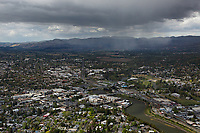 aerial photograph of Napa, California during a passing rain shower, Napa River in the foreground, Atlas Mountains in the background