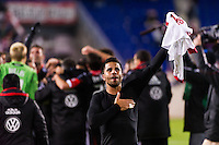 Marcelo Saragosa (11) of D. C. United salutes the fans after the match. D. C. United defeated the New York Red Bulls 1-0 (2-1 in aggregate) during the second leg of the MLS Eastern Conference Semifinals at Red Bull Arena in Harrison, NJ, on November 8, 2012.