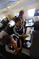 Wednesday 07 August 2013<br /> Pictured from TOP: Michu, Chico Flores and Angel Rangel playing a board game on an iPad en route to Malmo.<br /> Re: Swansea City FC travelling to Sweden for their Europa League 3rd Qualifying Round, Second Leg game against Malmo.